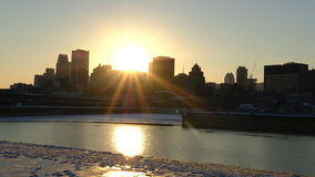 Sunset during winter behind canadian city stock video