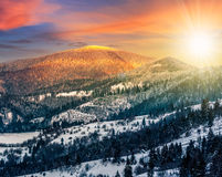 Sunset in winter carpathians. Carpathian mountain rural area near peaks in snow on frosty sunset in winter Royalty Free Stock Images