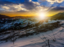 Sunset in winter carpathians. Carpathian mountain rural area near peaks in snow on frosty sunset in winter Stock Photography