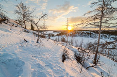 Sunset on winter coast of  lake. Stock Photos