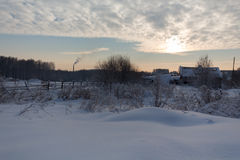 Sunset in winter country and a house Stock Photo