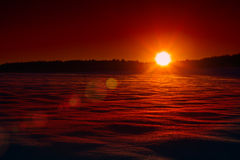 Sunset on the winter field Royalty Free Stock Image