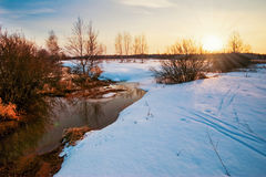 Sunset in winter field Stock Photography