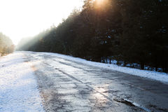 Sunset in winter forest and road Stock Image