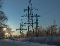 At sunset in winter, high-voltage support. stock photography