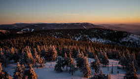 Sunset in winter hills. Sunset in czech mountains, clear sky Stock Images