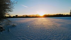 Sunset in a winter lake royalty free stock photography