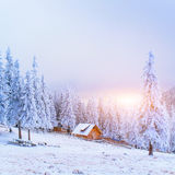 Sunset in the winter mountains and fantastic chalet Royalty Free Stock Image