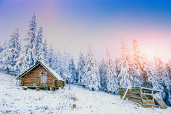 Sunset in the winter mountains and fantastic chalet Royalty Free Stock Photos