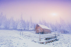 Sunset in the winter mountains and fantastic chalet Stock Images
