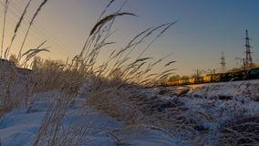 At sunset in winter, the ravine and the railroad royalty free stock image