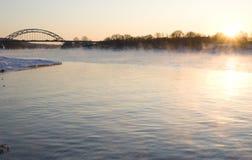 Sunset on winter river Stock Image
