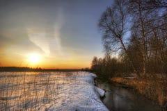 Sunset of winter river Stock Photos