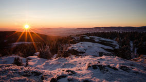 Sunset in the winter rocks. Sunset in czech mountains, clear sky Stock Photos