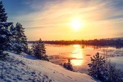 Sunset winter snow nature river horizon landscape. Winter snow forest river sunset view. Sunset winter river snow. Sunset winter snow nature river horizon royalty free stock photo