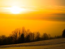 Sunset in wintertime Stock Images