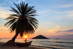 Sunset With Palm Tree And Boat At The Beach Stock Image