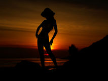 Sunset Woman. A colourful sunset image with a silhouette of a woman Royalty Free Stock Photography