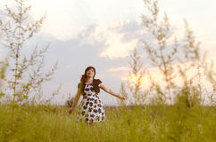 Sunset, woman, wilderness Royalty Free Stock Images