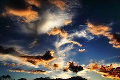 Sunset. Wonderful games of clouds at sunset Royalty Free Stock Photo
