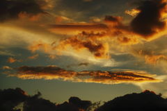 Sunset. Wonderful games of clouds at sunset Stock Photos