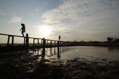 Sunset. On wood bridge Royalty Free Stock Photography