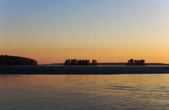 Sunset on wood lake Stock Photo