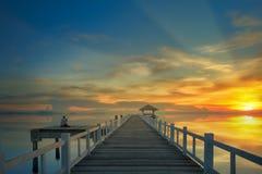 Sunset and wooded bridge Royalty Free Stock Image