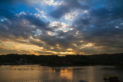 Sunset at the wooden bridge (Mon Bridge) over the river in sunse Royalty Free Stock Photo