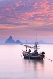 Sunset with wooden fishing boat in Thailand royalty free stock images