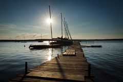 Sunset in wooden harbour stock images