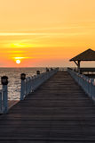Sunset at wooden pier Stock Image
