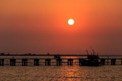 Sunset at wooden pier and ship Stock Images