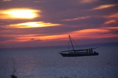 Sunset workers goin out for fishing. Fisherman going out at sunset to find some sardines to sell stock image