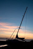 Sunset yacht. Silhouette of yacht with sunset background Royalty Free Stock Image