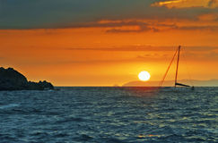 Sunset and yacht Stock Images