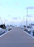 Sunset at a yacht harbor royalty free stock images