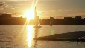 Sunset yacht lake river stock video