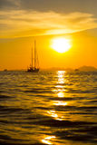Sunset and a yacht. At sea Royalty Free Stock Photos