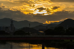 Sunset in Yamaguchi City, Japan. View from the riverside with colorful lights reflect on the water Royalty Free Stock Photos