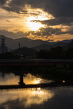 Sunset in Yamaguchi City, Japan. Views from the riverside with colorful lights reflect on the water Royalty Free Stock Image