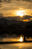 Sunset in Yamaguchi City, Japan. Views from the riverside with colorful lights reflect on the water Royalty Free Stock Photos