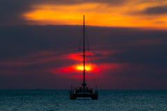 Sunset with yatch Stock Photo