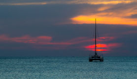 Sunset with yatch Stock Photos