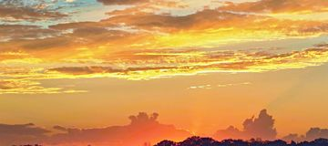 Sunset with yellow glow and crimson highliting. Colorfull Sunset in vicinity or Frazer Island with both Cumulus and Stratocumulus clouds highlighted. This stock photography