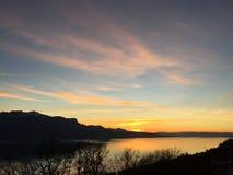 Sunset yellow pastel Sky clouds lake. Sunset yellow sky lake Geneva Royalty Free Stock Photos
