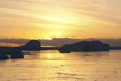 Sunset yellow winter night in the Antarctica. Royalty Free Stock Image