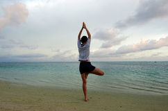 Sunset yoga on Aitutaki Lagoon Cook Islands Stock Photos