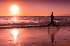 Sunset Yoga on the Beach Royalty Free Stock Images