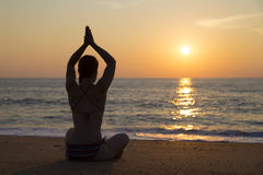 Sunset yoga on the beach Stock Images